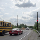 Photo of school bus on bridge