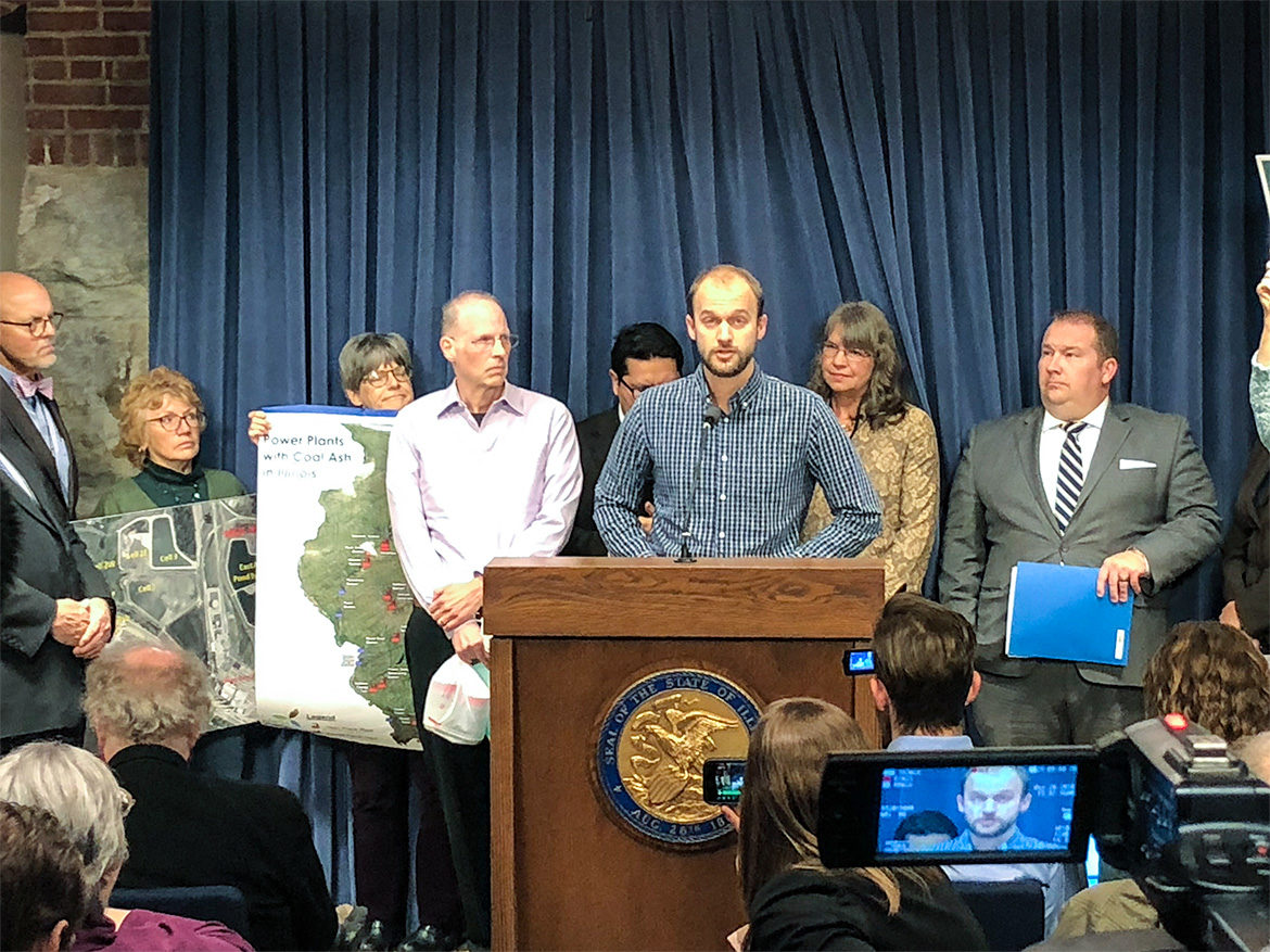 "Andrew Rehn of the Prairie Rivers Network presents the report ""Cap and Run: Toxic Coal Ash Left Behind by Big Polluters Threatens Illinois Water"" at a news conference at the Illinois state capitol building in Springfield"