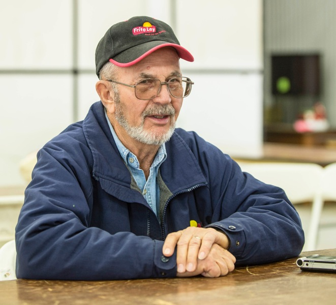 While many farmers are pleased that the new bill will maintain a strong crop insurance program, James Hughes of Philo Township, Ill., said he was indifferent because he never used crop insurance. Here, Hughes is shown sitting down at the Midwest Ag Expo at Gordyville's lunch area on Jan. 30, 2014.
