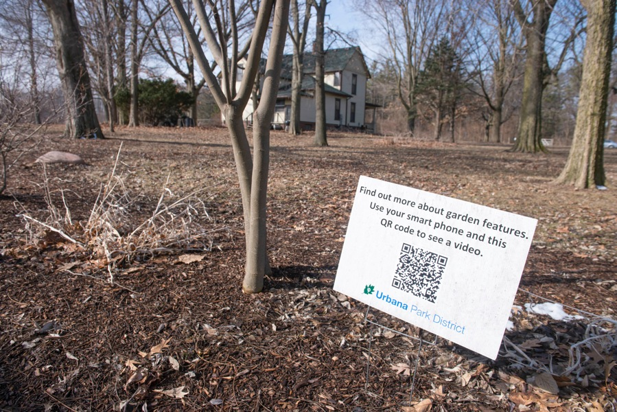 A sign placed at Meadowbrook Park in Urbana provides a 'QR code' for visitors to scan with their smartphones to learn more about the project, March 14, 2014.